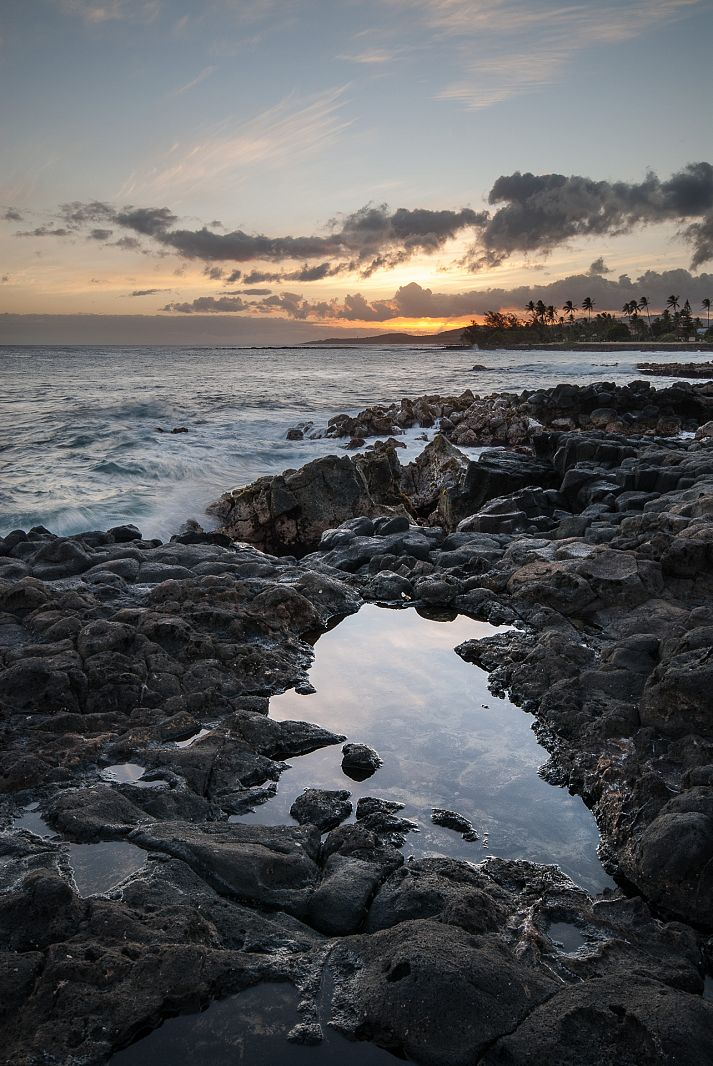 Sunset over lava rocks, Poipu, Hawaii, USA
