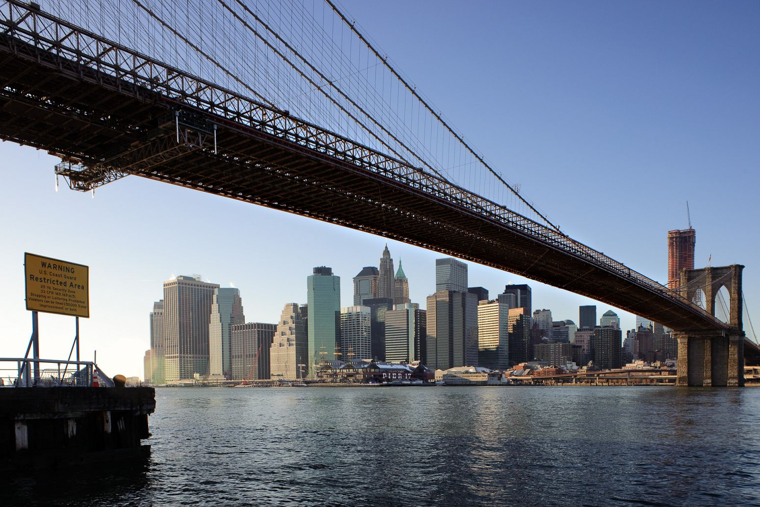 Manhattan and the Brooklyn Bridge from Empire Fulton Ferry, New York, USA