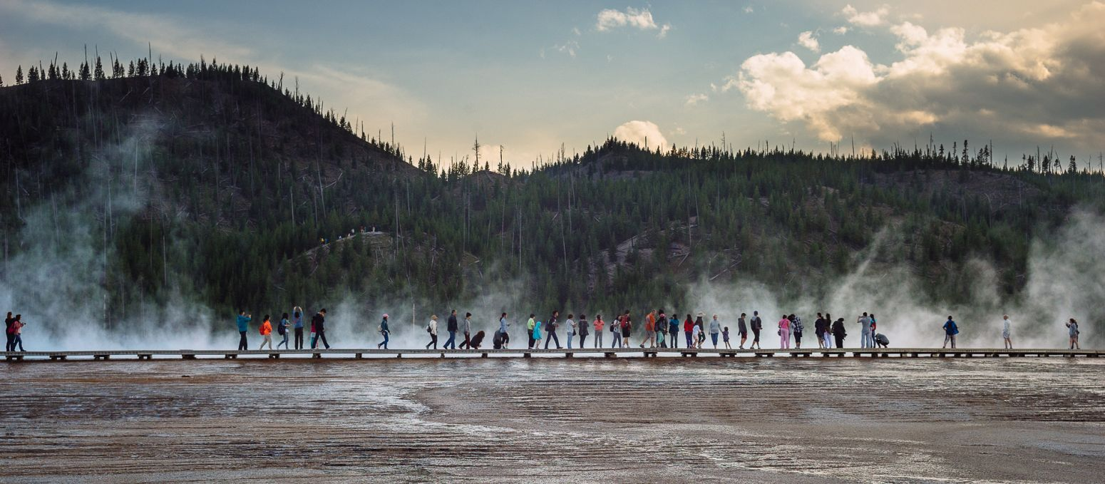 Tourists at Grand Prismatic spring, Yellowstone NP, Wyoming, USA