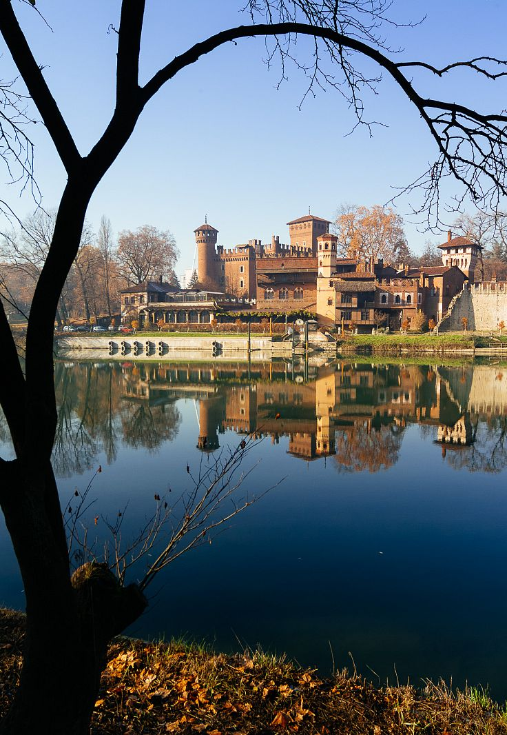 Castello del Valentino reflected on Po river, Torino, Italy