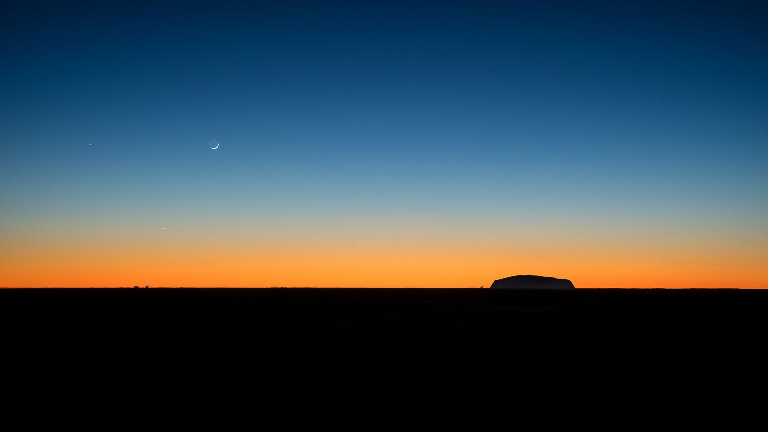 Uluru as seen from Kata Tjuta at sunrise, Northern Territory, Australia